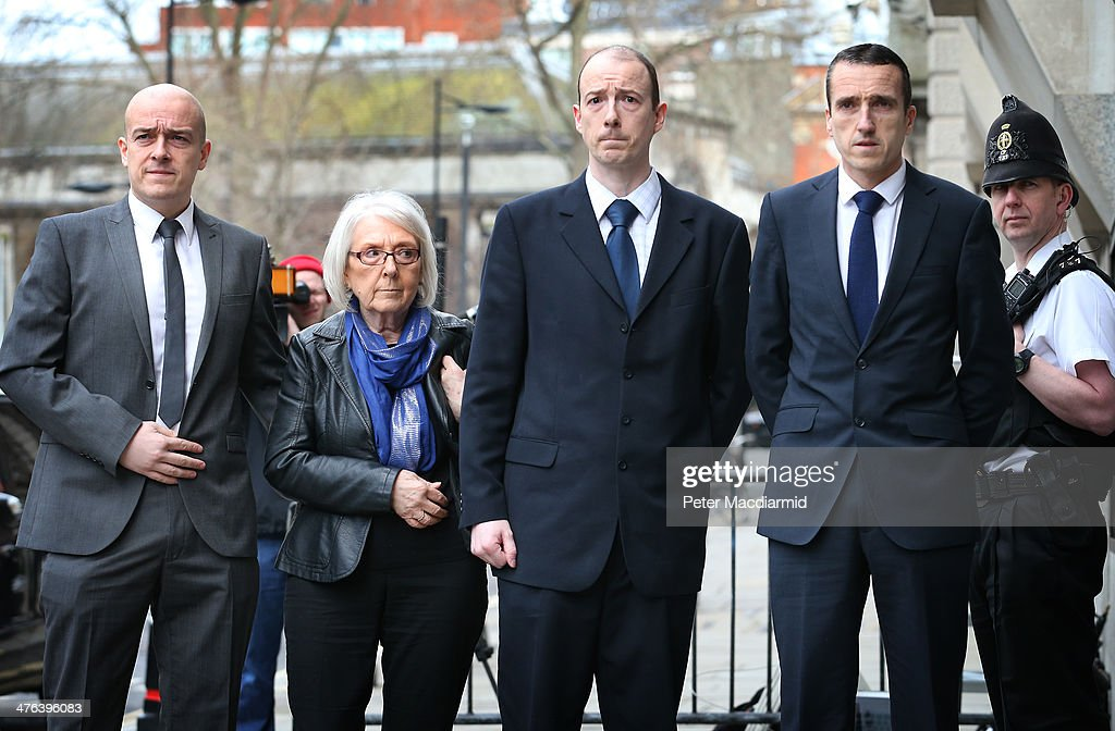 The family of PC (Police Constable) Keith Blakelock, his sons (L-R) Lee, Kevin and Mark Blakelock stand with their mother Elizabeth Johnson at the Old Bailey on March 3, 2014 in London, England. PC Blakelock was murdered by a mob during rioting at the Broadwater Farm housing estate in Tottenham, north London in 1985.