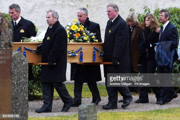 The family of Peter Wilson; mother Kirsty, sister Laura 16, and father Rupert follow his coffin after his funeral at the Church of Scotland church in...
