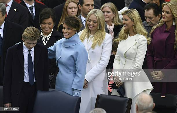TOPSHOT The family of Presidentelect Donald Trump son Barron wife Melania daughters Tiffany and Ivanka and daughterinlaw Vanessa arrive on the...