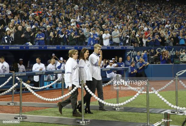 The family of Roy Halladay of the Toronto Blue Jays walk out onto the field as the widow of Roy Halladay Brandy Halladay and their two sons Braden...