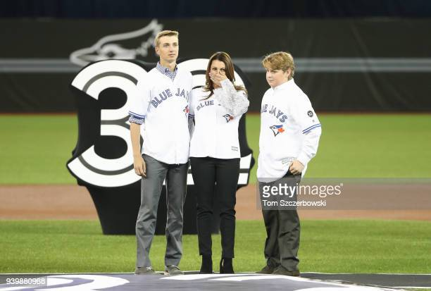 The family of Roy Halladay of the Toronto Blue Jays wife Brandy Halladay and their two sons Braden and Ryan in a ceremony on Opening Day during MLB...