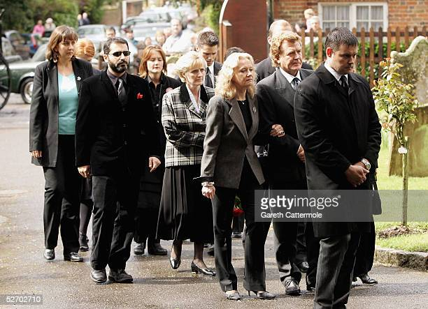 The family of Sir John Mills arrive at his funeral service on April 27 2005 in Denham