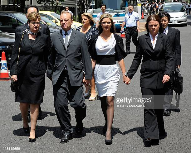 The family of slain 22-year-old British teacher Lindsay Ann Hawker, mother Julia father Bill, , snd sisters Lisa and Louise , hold hands as they...