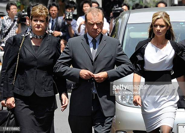 The family of slain 22-year-old British teacher Lindsay Ann Hawker, father Bill Hawker , mother Julia and sister Lisa arrive at Chiba District Court...