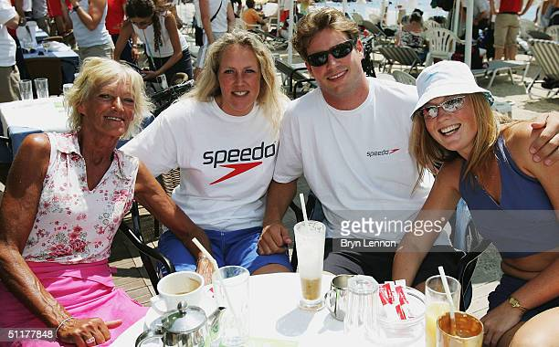The family of Speedo swimmer Inge de Bruijn mother Rika sister Jakline and brother Matthijs pose for a photograph with Matthijs' girlfriend Eva...