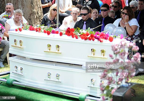 The family of the deseased mourn at the funeral of mother and son killed in last week's flash floods on January 19 2011 in Toowoomba Australia Donna...