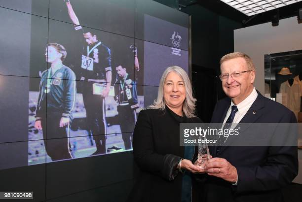 The family of the late Olympian Peter Norman represented by his daughter Janita Norman pose with AOC President John Coates during a posthumous Order...
