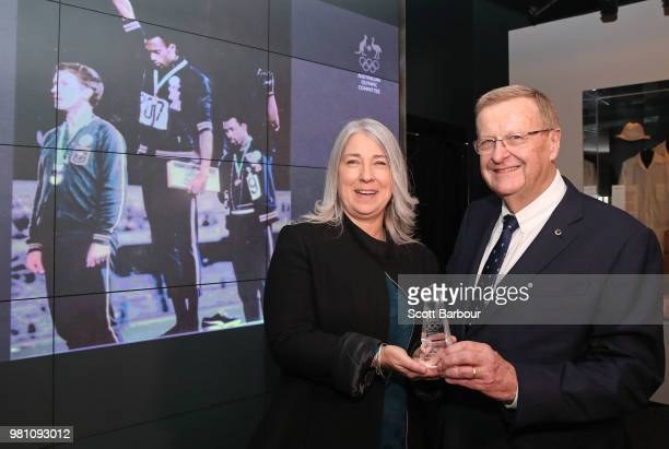The family of the late Olympian Peter Norman represented by his daughter Janita Norman poses with AOC President John Coates during a posthumous Order...