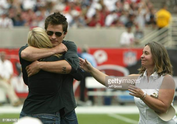 The family of the late Pat Tillman stands on the field for a tribute before the game between the Arizona Cardinals and the New England Patriots at...