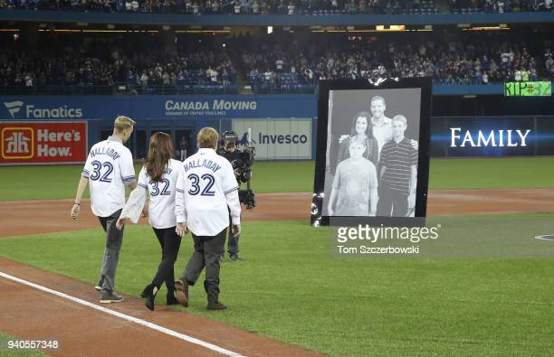 The family of the late Roy Halladay of the Toronto Blue Jays during a pregame ceremony honoring his memory as his widow Brandy Halladay and their two...