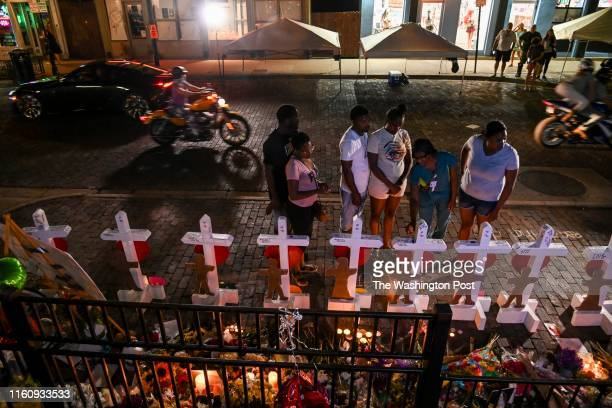 The family of Thomas TJ McNichols mourns at a makeshift memorial in front of the Hole in the Wall bar near the place where McNichols was killed by...