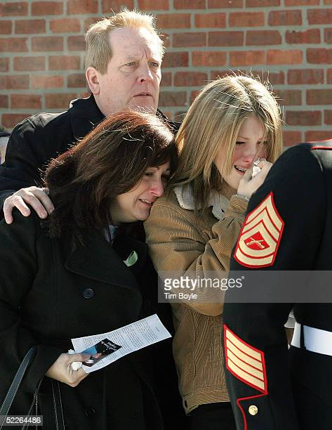 The family of US Marine Cpl John T Olson including his father John R Olson mother Diana J Olson and sister Courtney D Olson comfort one another upon...