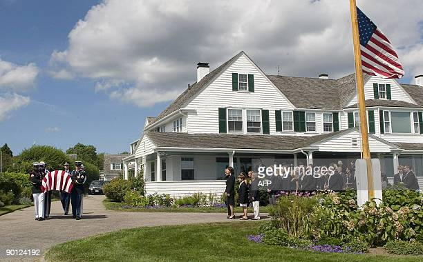 The family of US Sen Edward Kennedy watch as his casket is carried by an Honor Guard to a hearse at the Kennedy compound in Hyannis Port...