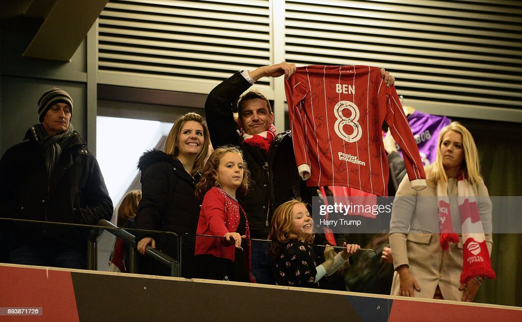 The family of Young Bristol City fan Benjamin Pritchard who sadly passed away aged 8 hold up a shirt dedicated to him at the final whistle during the Sky Bet Championship match between Bristol City and Nottingham Forest at Ashton Gate on December 16, 2017 in Bristol, England.