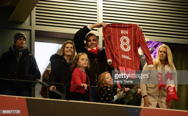 The family of Young Bristol City fan Benjamin Pritchard who sadly passed away aged 8 hold up a shirt dedicated to him at the final whistle during the...