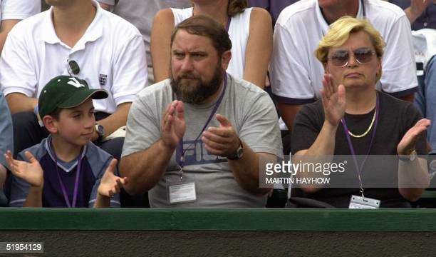 The family of Yugoslavborn Australian player Jelena Dokic brother Savo father Damir and mother Liliana watch her playing during her match at the...