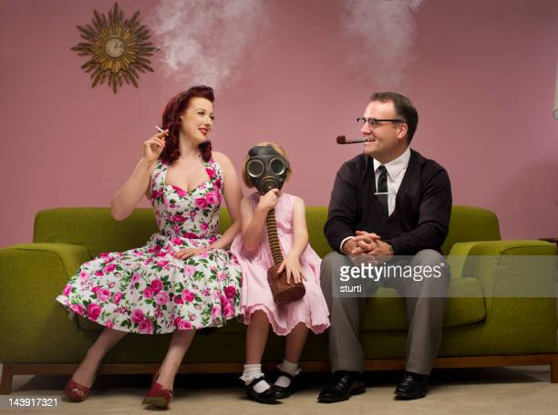 the family that smokes together - gas mask stock pictures, royalty-free photos & images