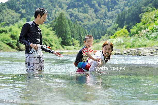 The family who does dabbling in the river