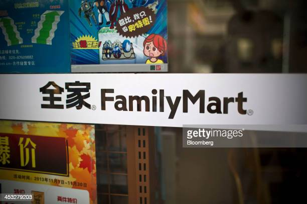 The FamilyMart Co logo is displayed on a convenience store window in the Tianhe district of Guangzhou China on Saturday Nov 30 2013 China's...