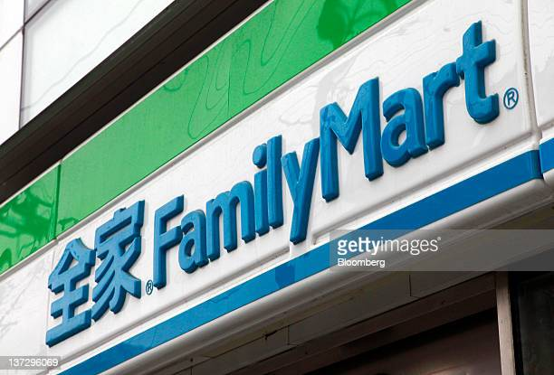 The FamilyMart Co logo is displayed outside a convenience store in Shanghai China on Sunday Jan 15 2012 FamilyMart Co Japan's largest convenience...