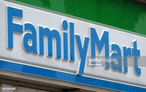 The FamilyMart Co logo is displayed outside one of the company's convenience stores in Tokyo Japan on Wednesday July 23 2014 Japan suspended food...
