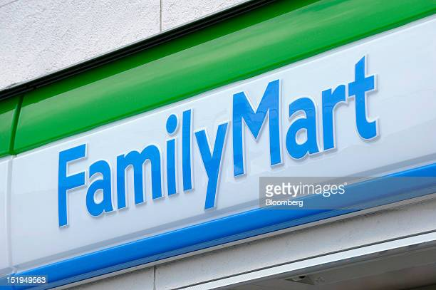 The FamilyMart Co logo is displayed outside the company's convenience store in Yokohama City Kanagawa Prefecture Japan on Tuesday Sept 11 2012 Sales...