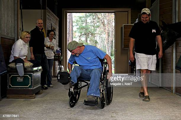 CONTENT] The family's father going forward in a wheelchair while others watch on The wheelchair obstacle course was built using canned vegetables and...