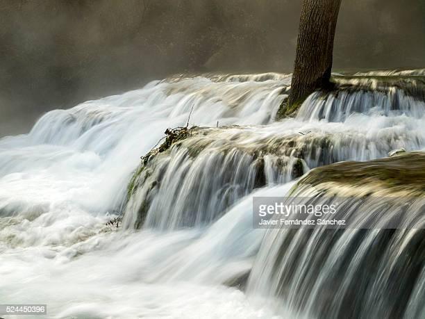 The famous and beautiful waterfall Orbaneja del Castillo, Spain.