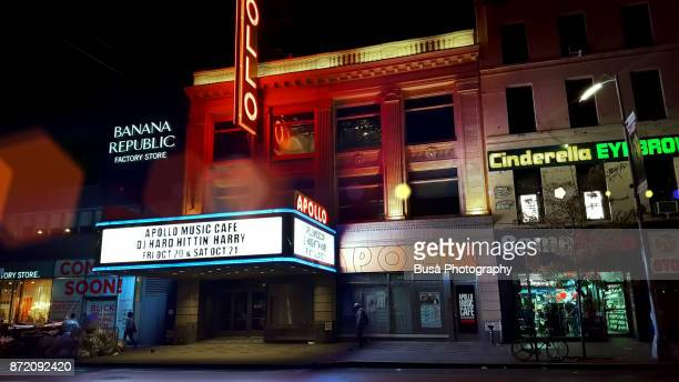 the famous apollo theater along 125th street in harlem, manhattan, new york city, at night - ハーレム・ルネサンス ストックフォトと画像