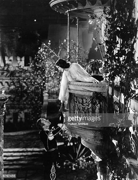 The famous balcony scene from the film version of Shakespeare's 'Romeo And Juliet' featuring Norma Shearer as Juliet and Leslie Howard as Romeo The...