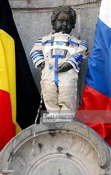 The famous Belgian icon Manneken Pis performs his duty with a Russian cosmonaut suit offered by the members of the International Space mission...