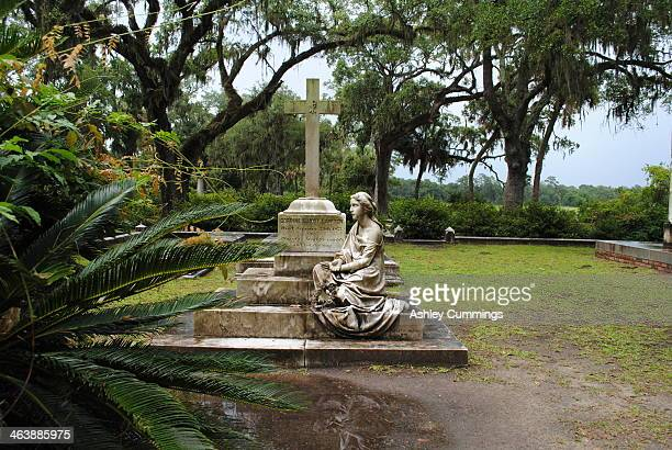 The famous Bonaventure Cemetery,Savannah,Georgiaon a stormy day.Surrounded by live oaks with grey Spanish moss is the grave of Corinne Elliot Lawton,...