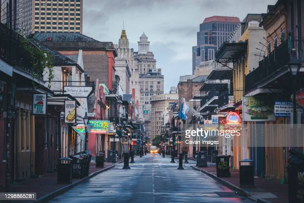 the famous bourbon street in new orleans without people in the morning - bourbon whiskey stock pictures, royalty-free photos & images