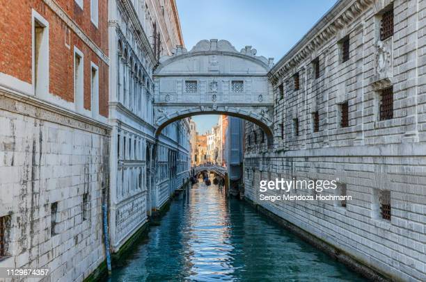 the famous bridge of sighs in venice, italy - unesco stock-fotos und bilder
