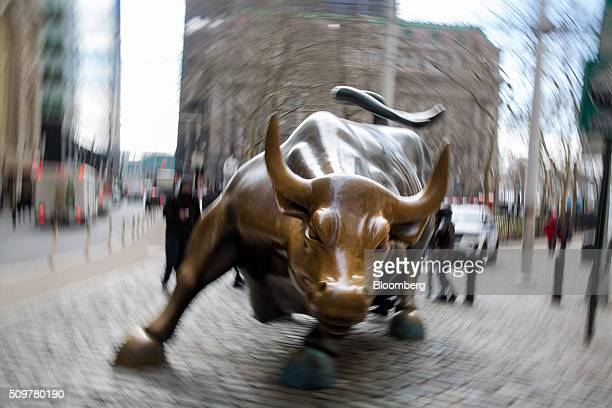 The famous bull sculpture stands near Wall Street in New York US on Friday Feb 12 2016 US stocks halted a fiveday slide that dragged global equities...