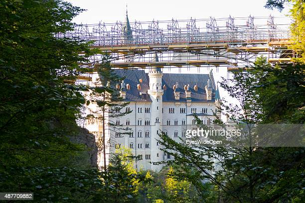The famous Castle Neuschwanstein with its building site bridge Marienbruecke under construction and renovation on August 31 2015 in Hohenschwangau...