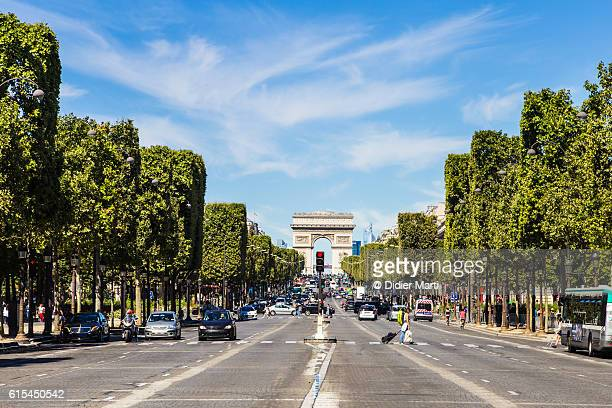 the famous champs elysees avenue in paris - champs elysees quarter stock pictures, royalty-free photos & images