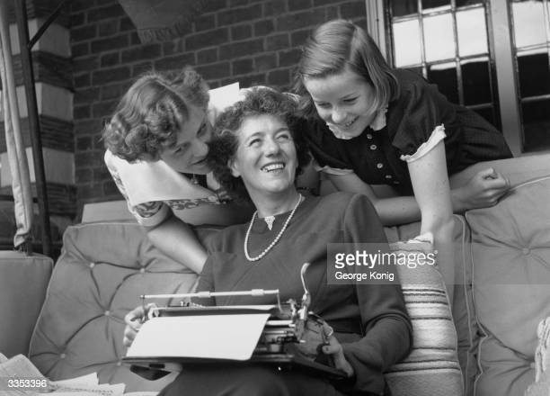The famous children's author Enid Blyton with her two daughters Gillian and Imogen at their home in Beaconsfield, Buckinghamshire.
