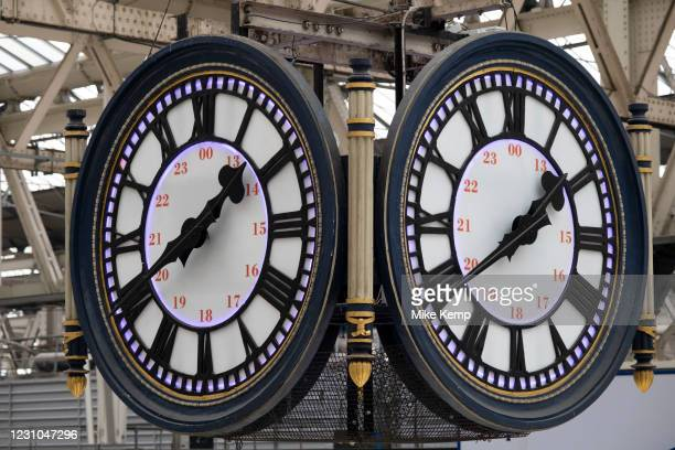 The famous clock at Waterloo Station on 28th January 2021 in London, United Kingdom. The four-faced clock hangs in the middle of the main concourse....