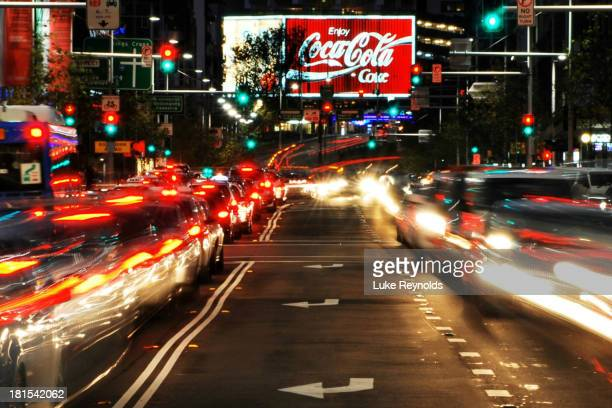 The famous Coke billboard lingers over the infamous Kings Cross strip as traffic flows along William St.