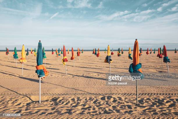 the famous colorful parasols on deauville beach, normandy, northern france, europe - north stock pictures, royalty-free photos & images