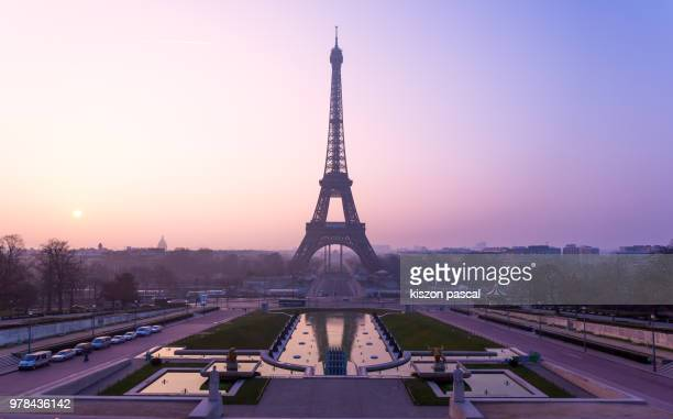 the famous Eiffel tower in Paris during a colorful sunrise , France