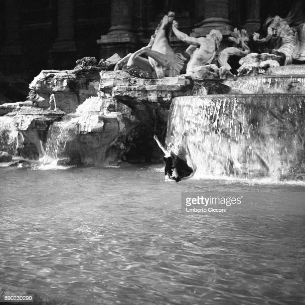 The famous film set of 'La Dolce Vita' at Trevi Fountain while the actress Anita Ekberg take a bath in the 'Trevi fountain' Rome 1959