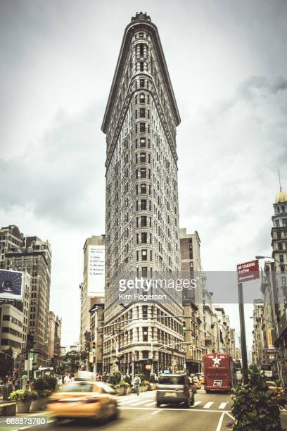 The Famous Flat Iron with Traffic Going By