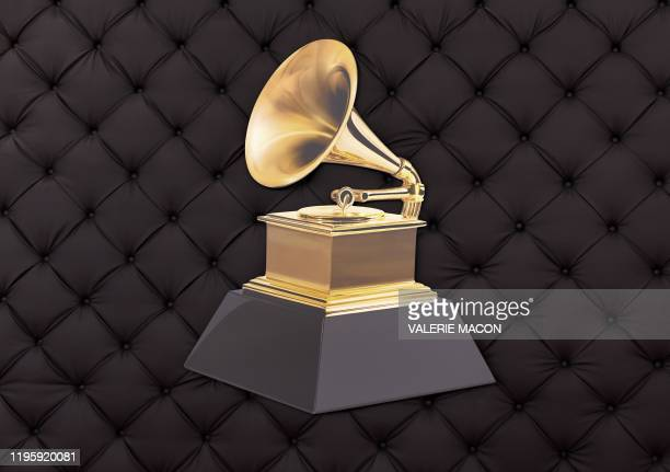 The famous gold gramophone best know as the Grammy logo is seen on a backdrop as the celebrity arrival area is being set up ahead of the 62nd Annual...