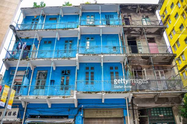 The famous Grade Ilisted Blue House in Hong Kong is one of the last remaining examples of this type of balconied tenement architecture in Hong Kong