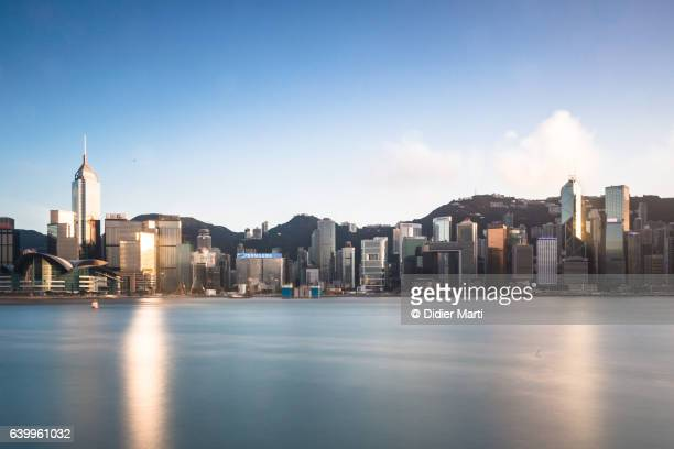 the famous hong kong island skyline captured with a long exposure - emerging markets stock photos and pictures