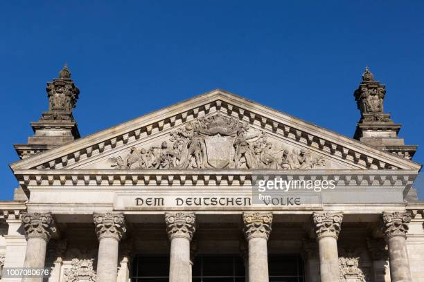 The famous inscription on the architrave on the west portal of the Reichstag building in Berlin: 'Dem Deutschen Volke' (Germany)