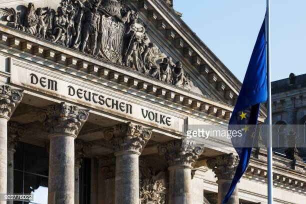 The famous inscription on the architrave on the west portal of the Reichstag building in Berlin: 'Dem Deutschen Volke' with EU-flag