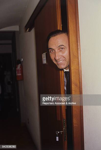 The famous Italian TV host Pippo Baudo looking out of the dressing room of his second wife Katia Ricciarelli famous Italian soprano during her...
